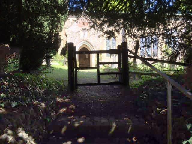 The gateway leading to St John the Baptist Church, Alderford